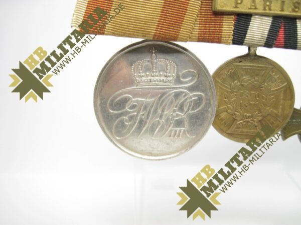 IMG 8109 600x450 - Preussen: Ordensschnalle Medaille Verdienste um den Staat. Erinnerungskreuz Königgrätz, Gefechtsspangen Gravelotte, Paris, Zentarmedaille, Kriegsdenkmünze 1870/71